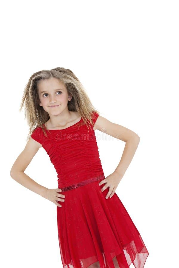 掀动女孩的图象红色连衣裙的用在臀部的手在白色背景 免版税库存图片