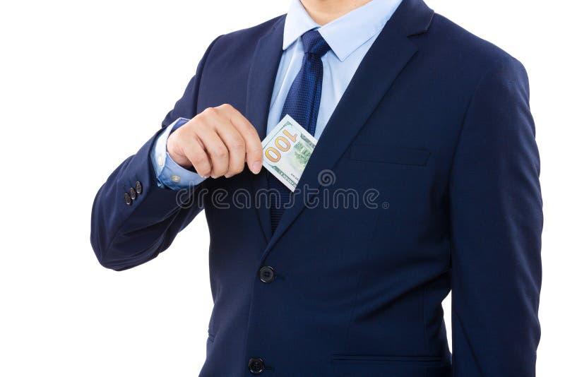 去掉从口袋的商人金钱 库存照片