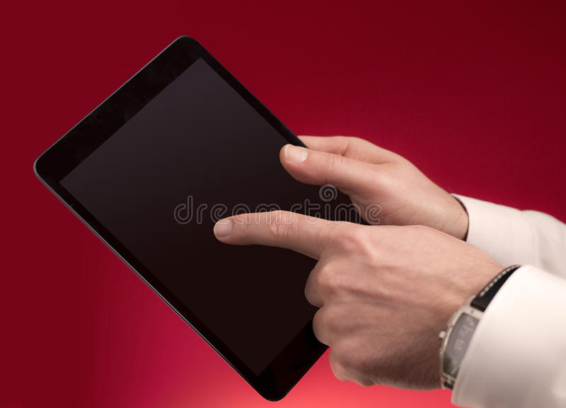 接触在红色的一种片剂 库存照片