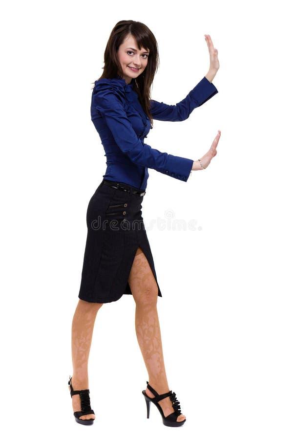 接触某事,演播室画象的女商人站立在白色背景隔绝的全长 免版税库存照片