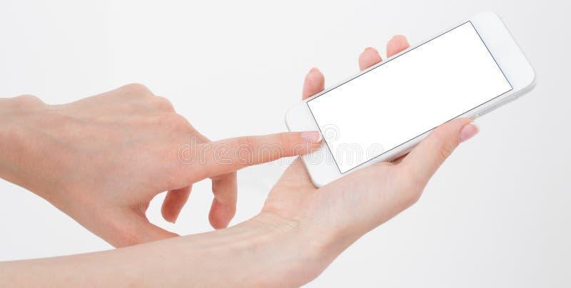 接触空白的女性手srceen在白色背景隔绝的电话,拷贝空间 库存照片