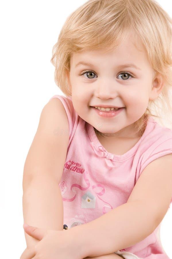接近的女孩愉快的小的面带笑容  图库摄影