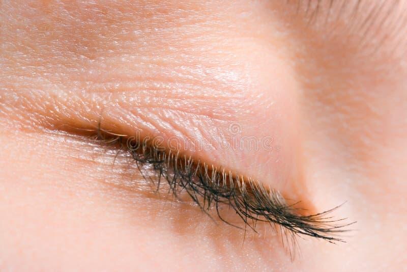 接近的眼睛睫毛上升妇女 库存图片