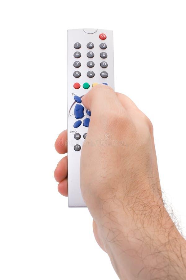 控制拿着远程电视的现有量 免版税库存图片