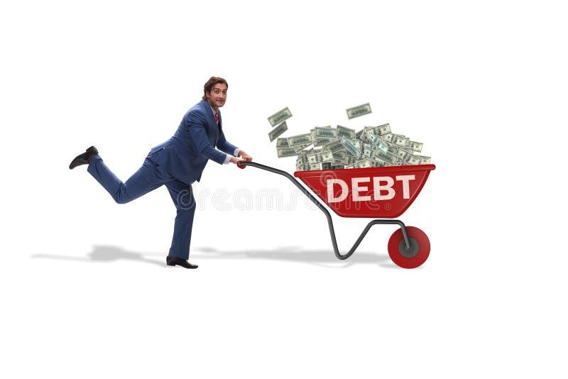 推挤在债务贷款概念的商人独轮车 免版税库存照片