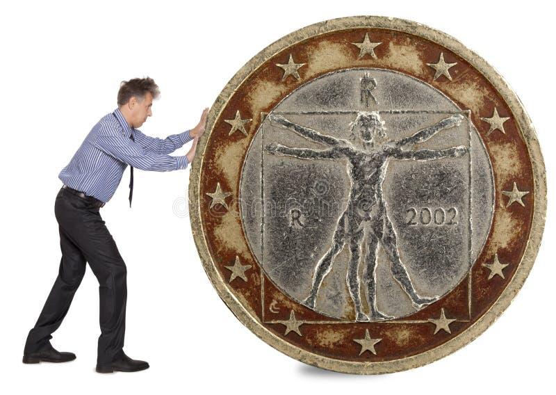 推挤欧洲硬币的商人 免版税库存照片