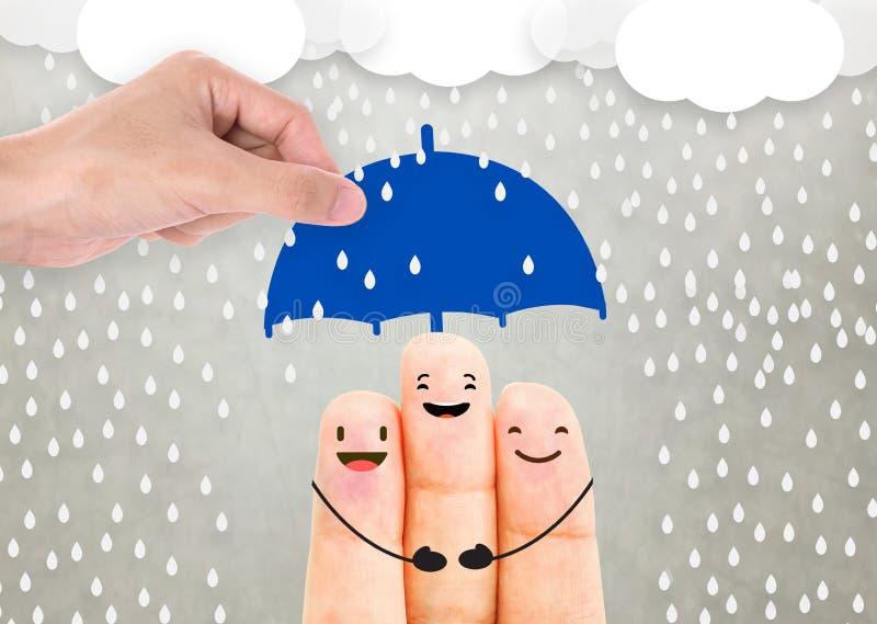 推销员拿着伞保护家庭的代理手 库存图片