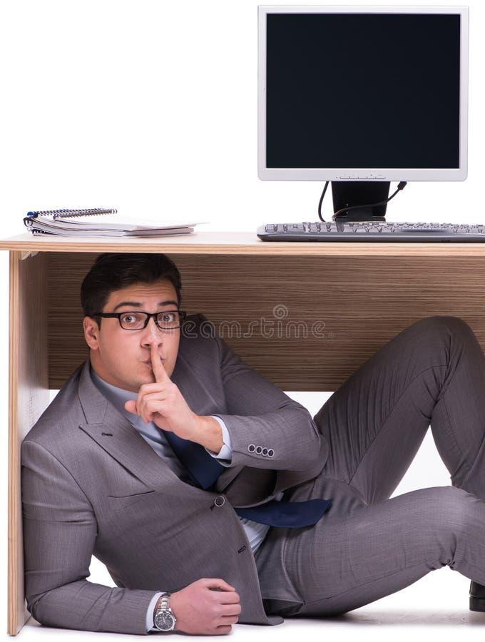 掩藏在ofice的商人 免版税图库摄影