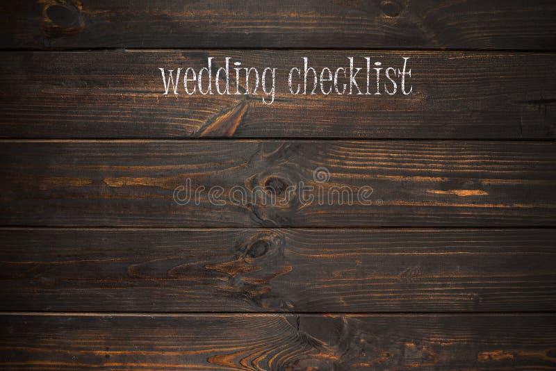 措辞在一块木板材写的婚礼清单 库存照片