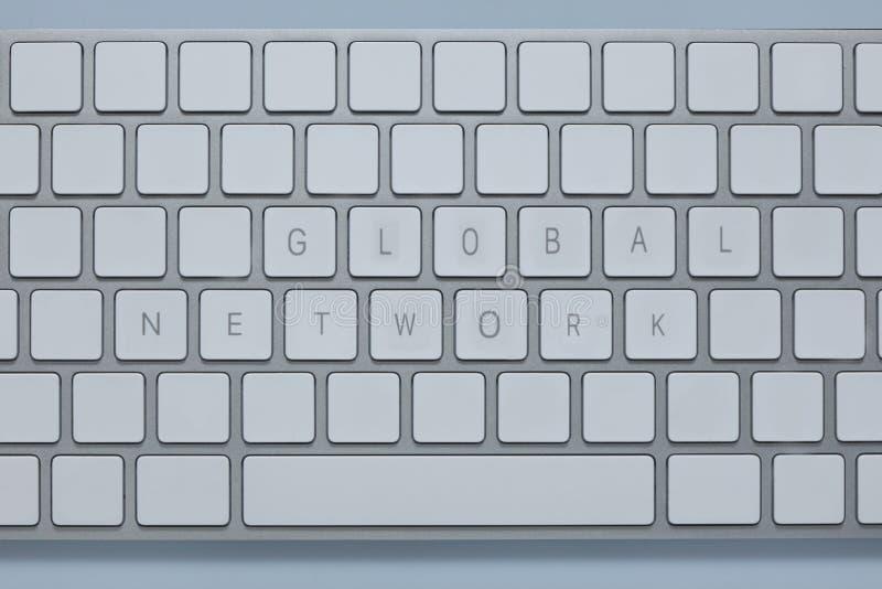 措辞在键盘的全球网络有其他的锁上删除 库存照片