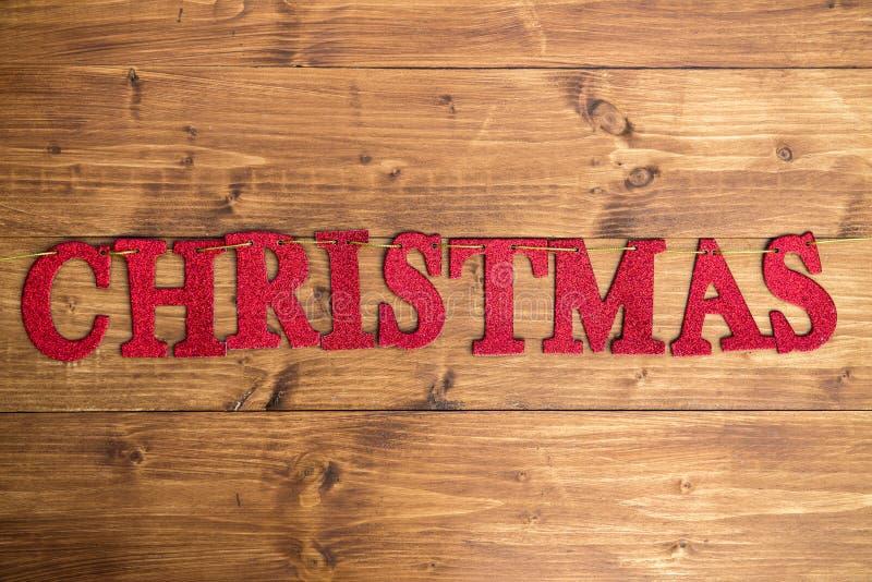 措辞由红色闪烁的信件做的圣诞节安置在St 免版税库存图片