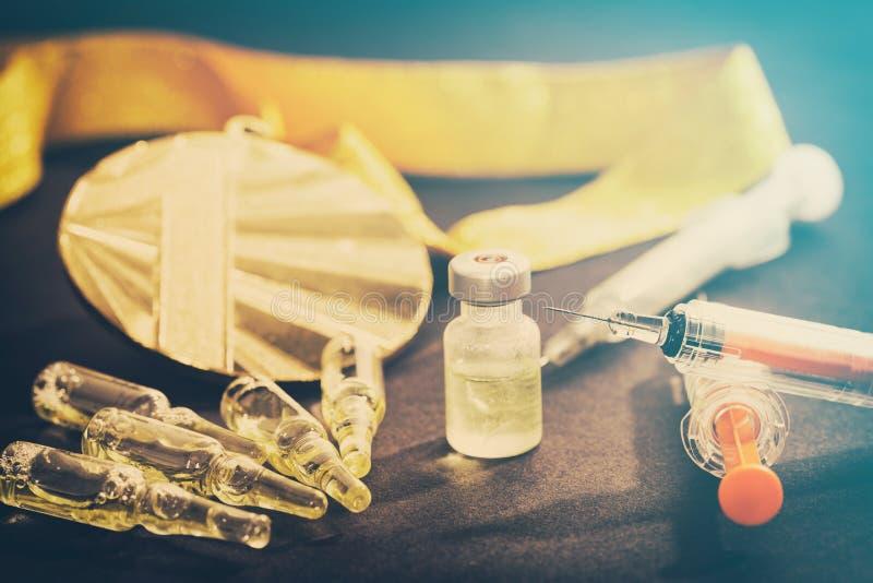 掺杂类固醇体育药物健康特写镜头赢取注射器 免版税库存图片