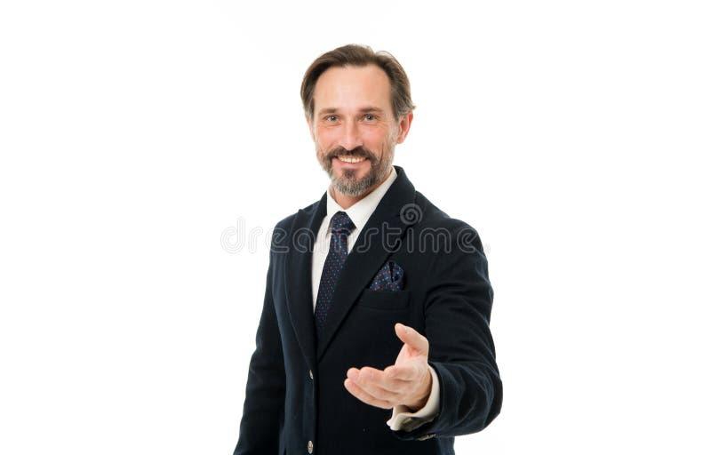 提供他的手 企业样式的有胡子的成熟人 在礼服的成熟商人 有灰色胡子的老人 免版税图库摄影