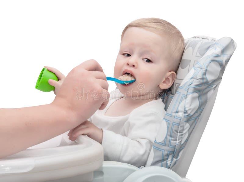 提供少许匙子的婴孩 库存照片