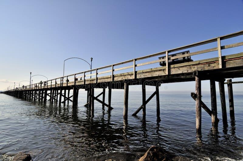 提供援助对海运的木码头 免版税库存照片