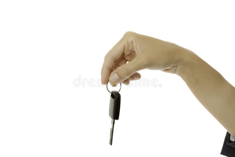 提供汽车钥匙的手 免版税库存图片