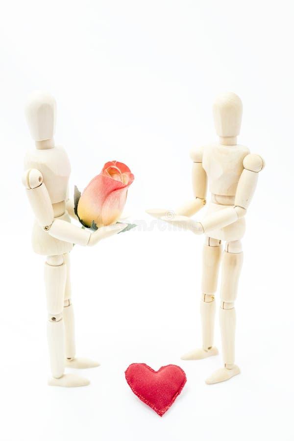 提供玫瑰的人为妇女 图库摄影