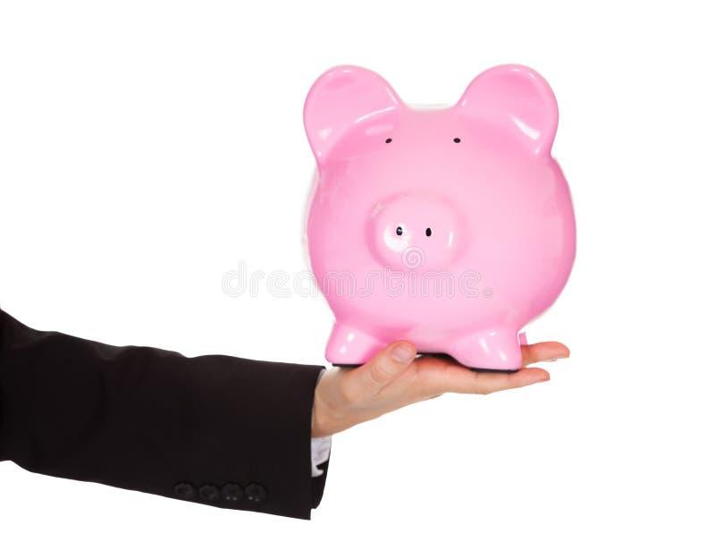 提供piggybank的生意人 库存图片