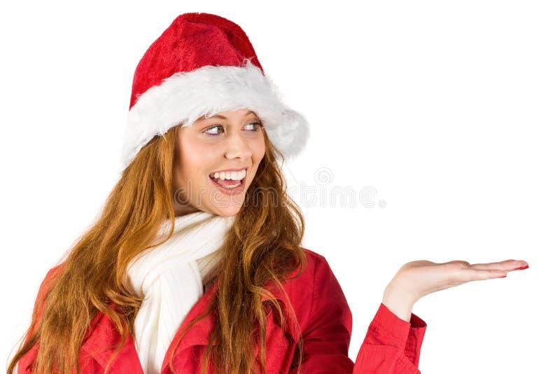 提出用手的欢乐红头发人 免版税图库摄影