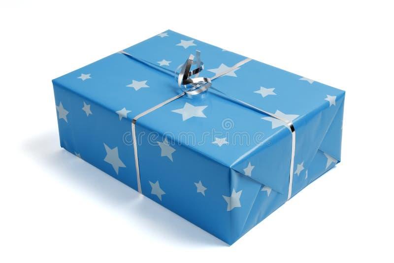 提出,与蓝纸和银色星 免版税图库摄影
