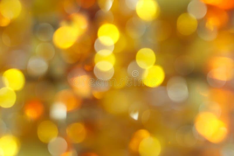 提取被弄脏的背景-琥珀黄色,绿色和橙色闪烁光bokeh  免版税图库摄影
