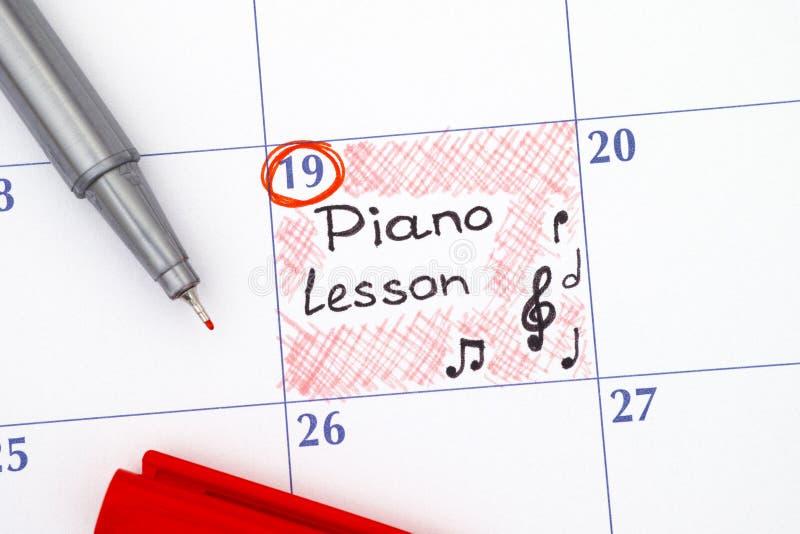 提示在日历的钢琴课 库存图片