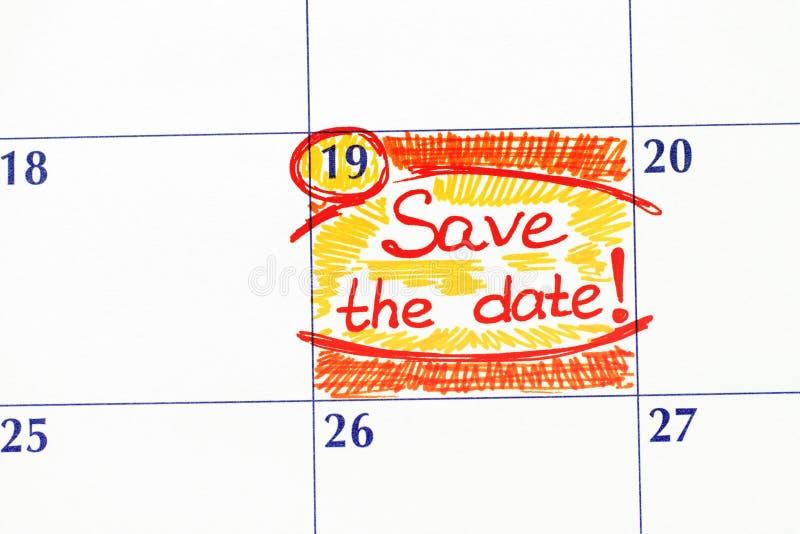 提示救球在日历的日期 免版税库存照片