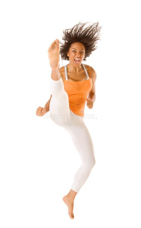 插入体育运动妇女的种族跳的空手道 免版税库存照片