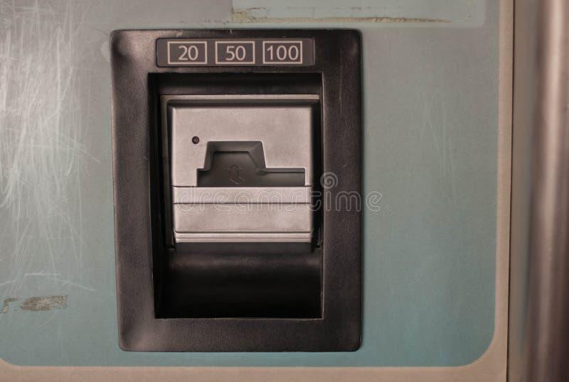 插入投币口20 50 100在处所 免版税图库摄影
