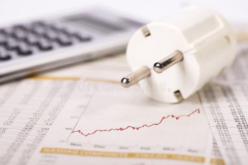 插座、计算器和金钱 免版税库存图片
