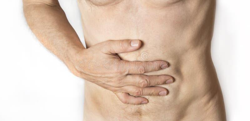 握他的腹部的人 胃和消化不良问题 库存图片