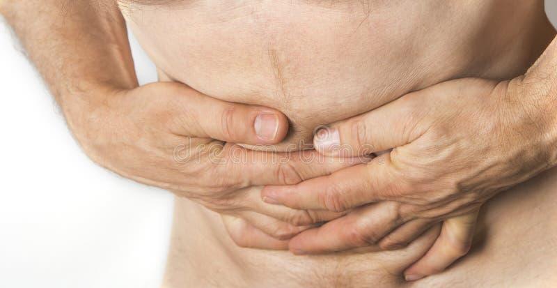 握他的腹部的人 胃和消化不良问题 免版税库存照片