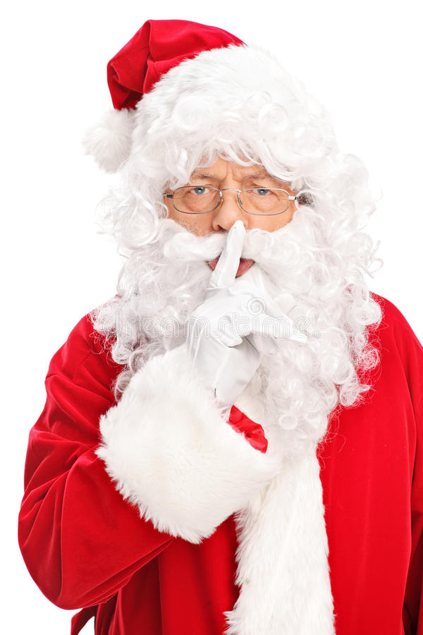 握在他的嘴唇的圣诞老人一个手指 库存照片