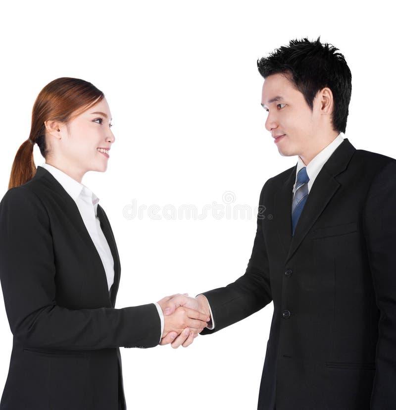 握在w和女实业家之间的手隔绝的商人 库存图片
