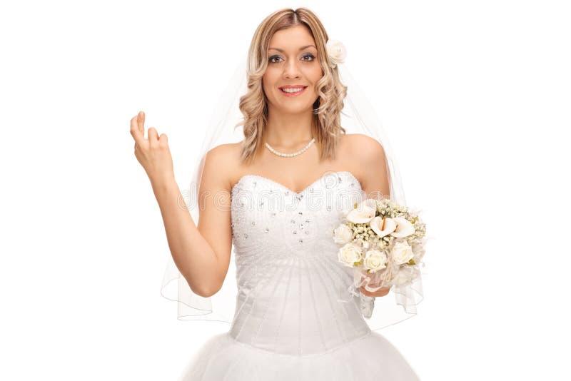握她的年轻新娘但愿 免版税库存图片
