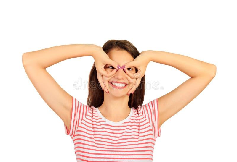 握手指的可笑的疯狂的女孩临近象玻璃和做鬼脸的眼睛 在白色背景隔绝的情感女孩 库存照片