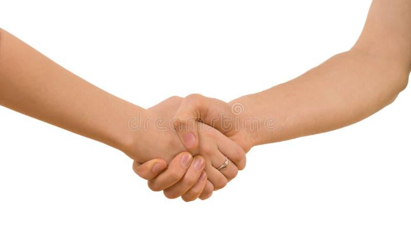年轻握手的人和妇女 库存照片