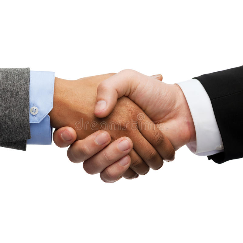 握手的商人和女实业家 免版税库存照片