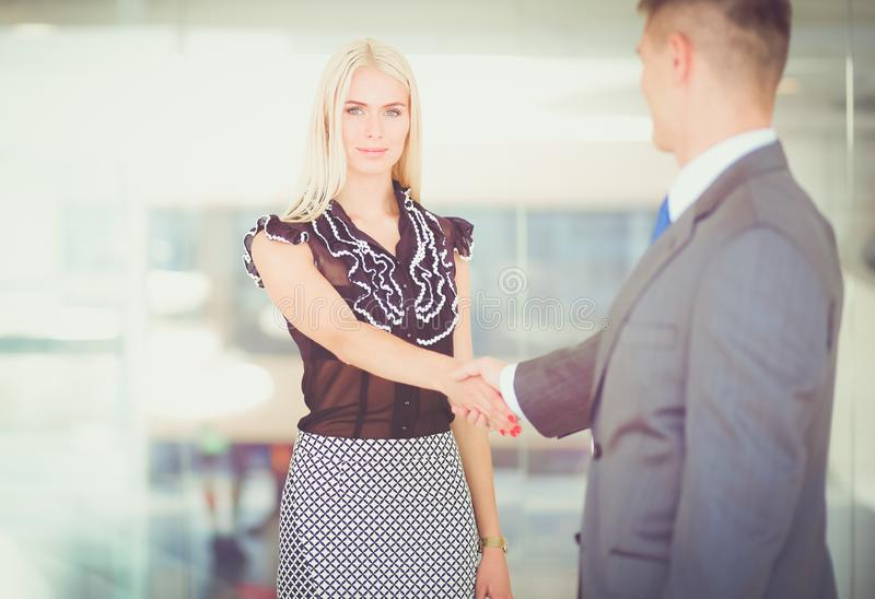 握手的商人在见面以后 库存照片
