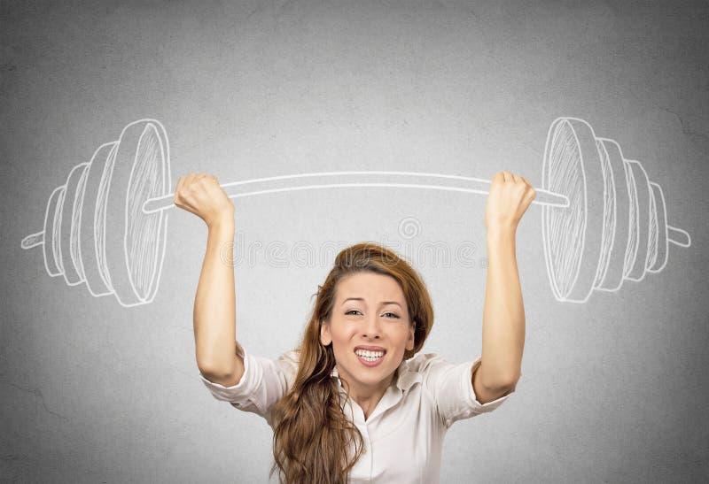 握手的女实业家速写了杠铃,特别重的人 免版税库存图片