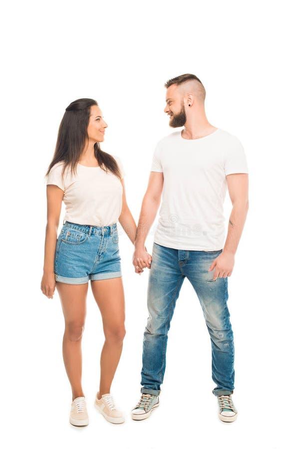 握手的年轻有吸引力的夫妇全长画象, 库存图片
