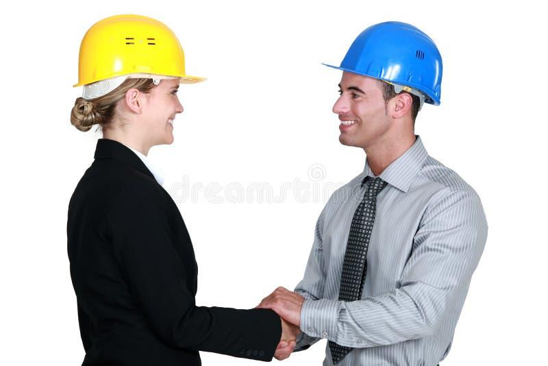 握手的建筑师 库存图片