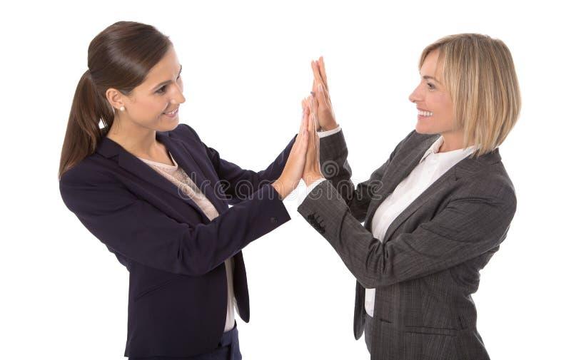 握手的成功庆祝和被隔绝的女实业家 库存照片