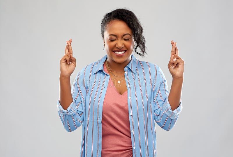 握的非裔美国人的妇女但愿 免版税库存图片