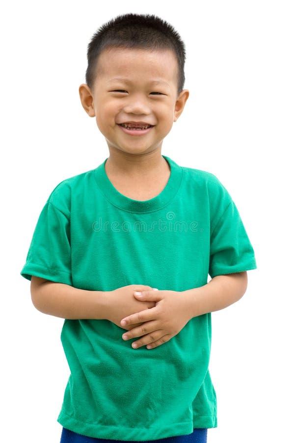 握胃的亚裔孩子 免版税库存照片