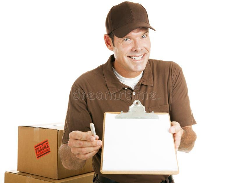 搬家工人需要您的签名 免版税库存图片