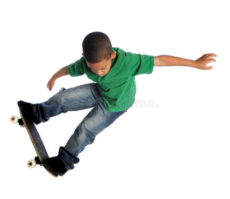 搭乘儿童冰鞋年轻人 库存照片