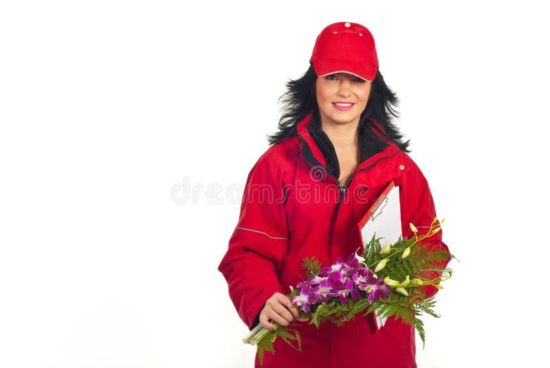 搭载花微笑的妇女 免版税库存照片