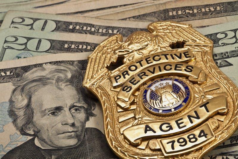 摄影师做的假徽章在货币 库存照片