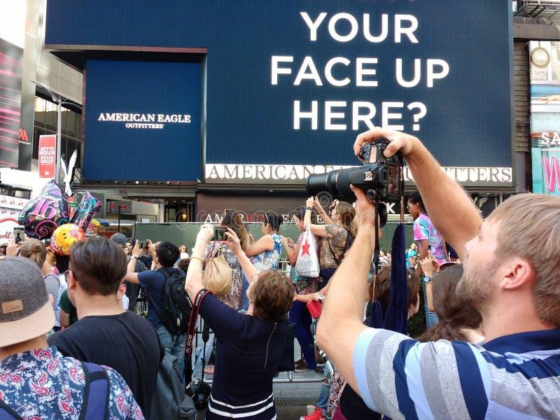 摄影师在时代广场,无固定职业的摄影师, NYC,美国 免版税图库摄影